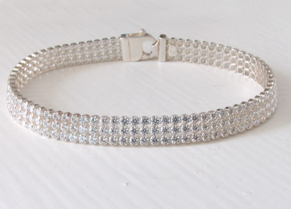 White Cubic Zirconia and Sterling Silver Triple Strand Tennis Bracelet